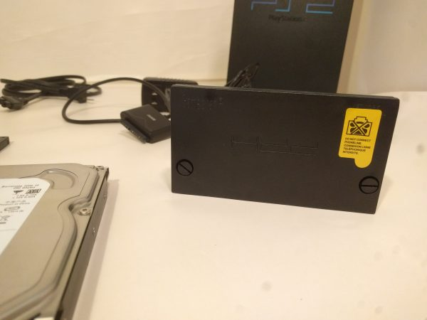 PS2 Softmod Bundle front of hard drive adapter.